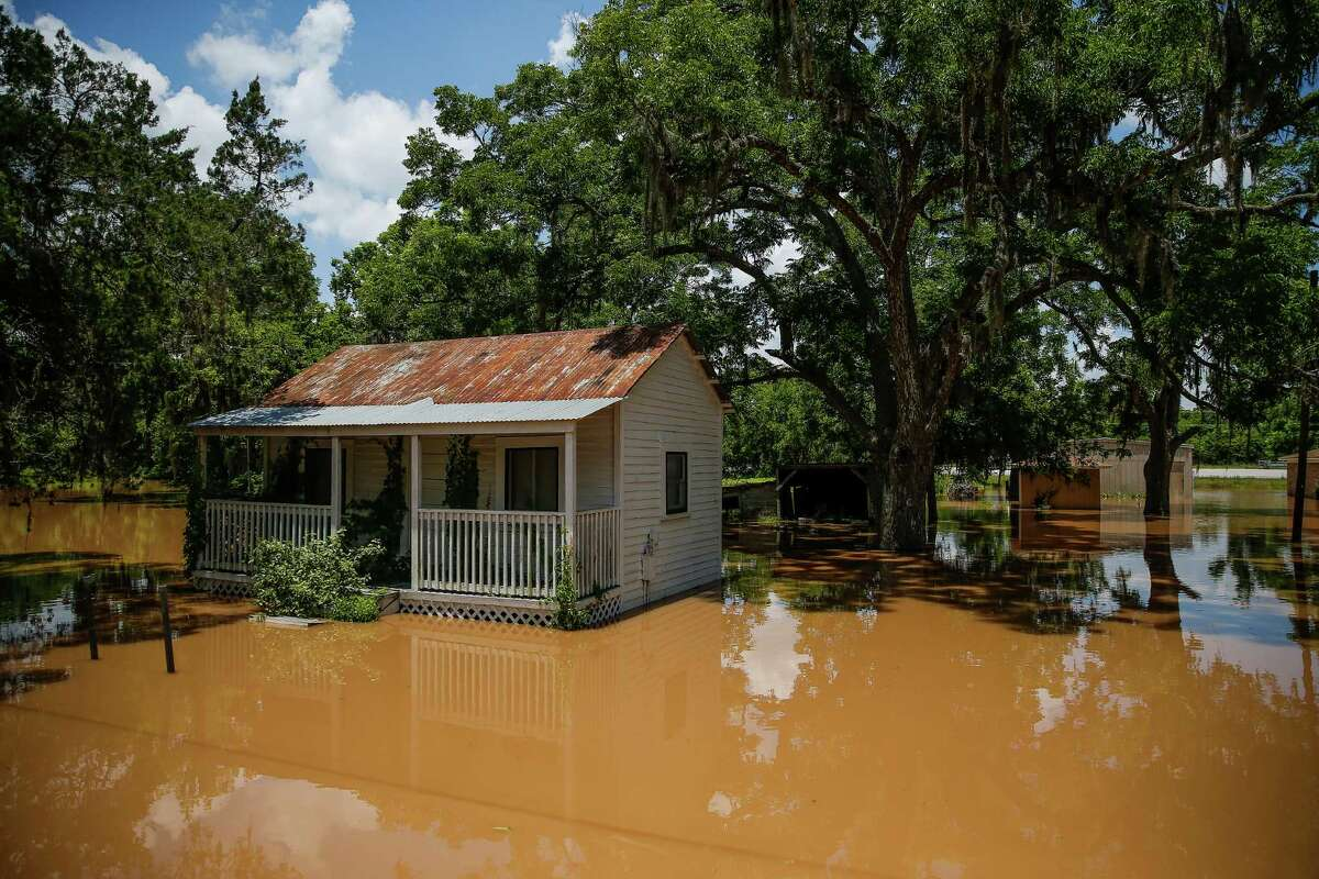 East Columbia, a smaller community than its western neighbor, is entirely submerged, authorities say. A home is surrounded by flood waters Tuesday, June 7, 2016 in East Columbia. ( Michael Ciaglo / Houston Chronicle )