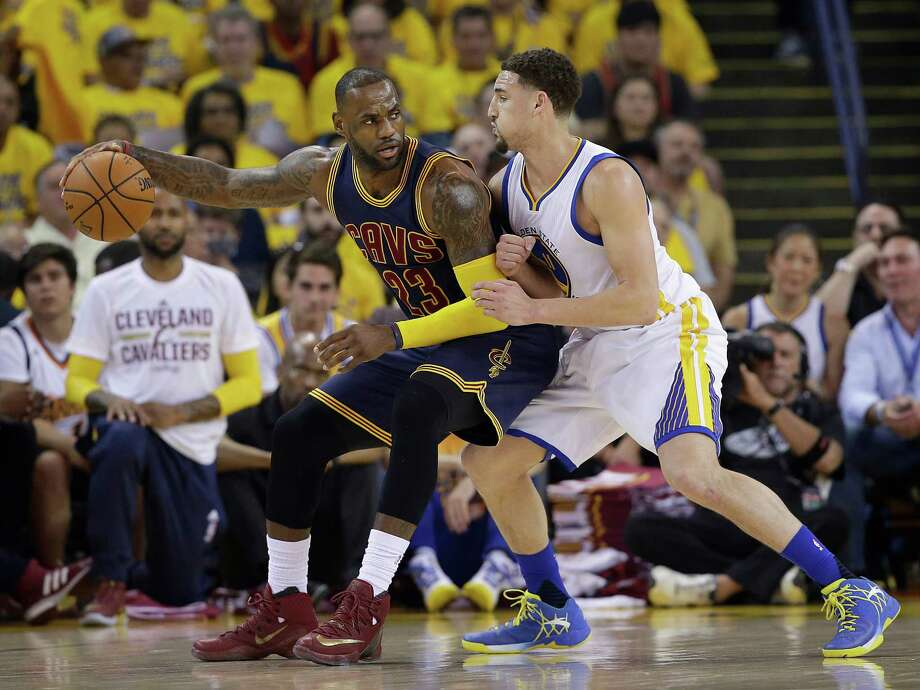 Cleveland Cavaliers forward LeBron James (23) dribbles against Golden State Warriors guard Klay Thompson during the first half of Game 1 of basketball's NBA Finals in Oakland, Calif., Thursday, June 2, 2016. (AP Photo/Marcio Jose Sanchez) ORG XMIT: OAS106 Photo: Marcio Jose Sanchez / AP