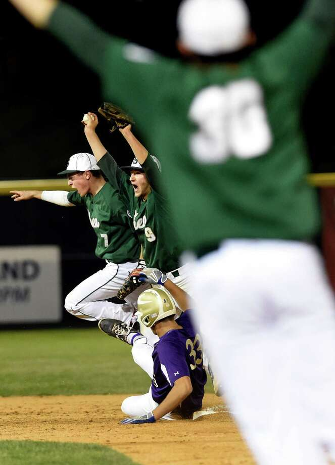 Shen's infielders Nick Jacques, left, Nik Malachowski, center, and Joe Fraser celebrate when CBA's William Van Beusekom is forced out at second to win the Class AA baseball final 3-0 on Thursday, May 26, 2016, at Joe Bruno Stadium in Troy, N.Y. (Cindy Schultz / Times Union) Photo: Cindy Schultz / Albany Times Union