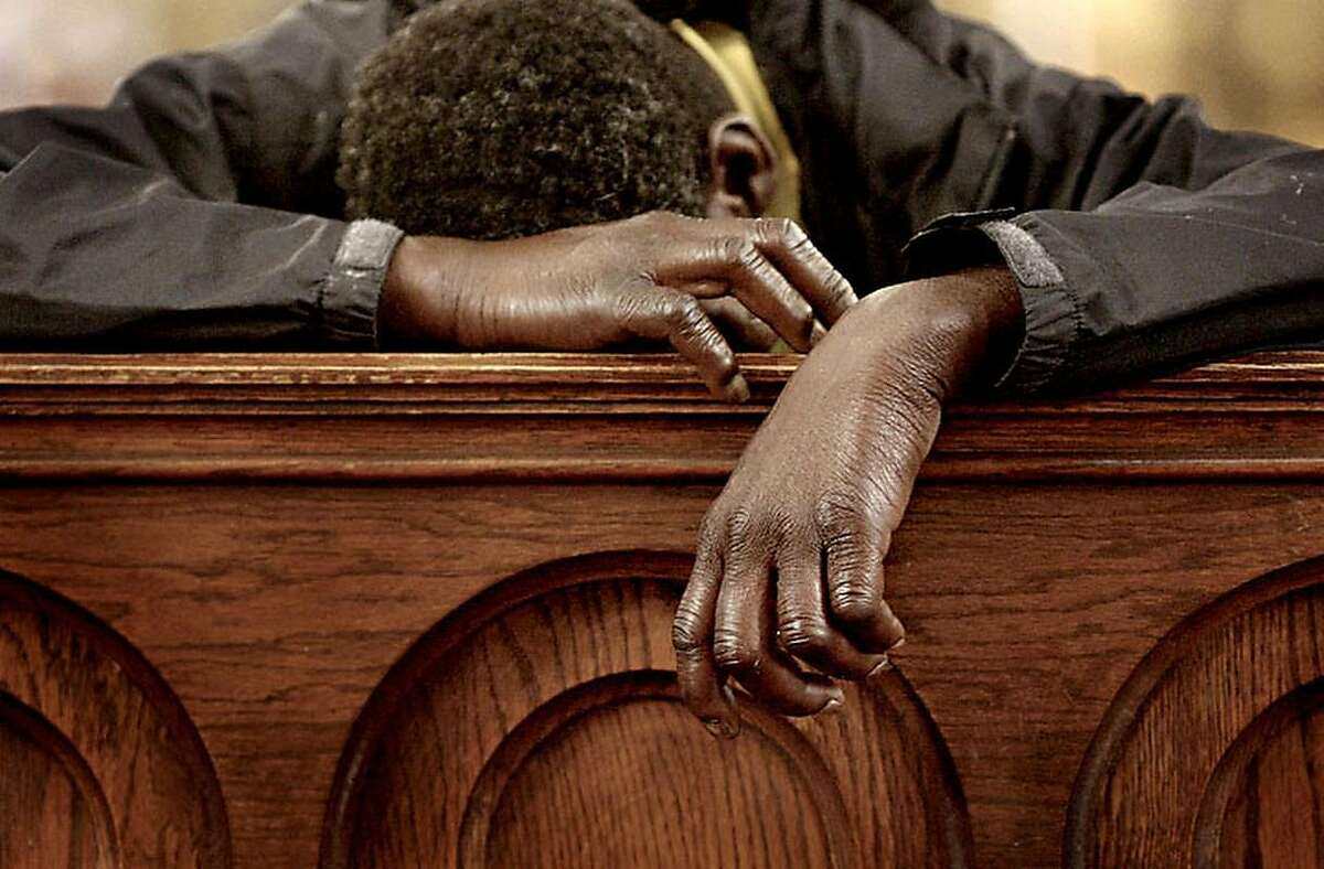 Homeless in San Francisco: SF Homeless Project Jerome, a homeless man, uses a pew to catch up on sleep at St. Boniface Catholic Church in San Francisco's Tenderloin neighborhood in this 2006 photo.