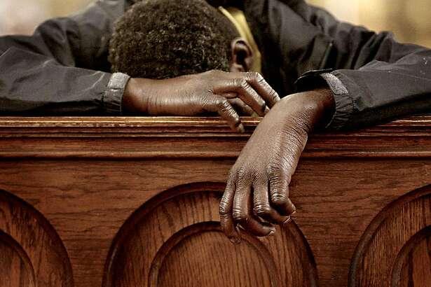 Jerome, a homeless man, uses a pew to catch up on sleep at St. Boniface Catholic Church in San Francisco's Tenderloin neighborhood. Brant Ward / The Chronicle  Ran on: 10-16-2006