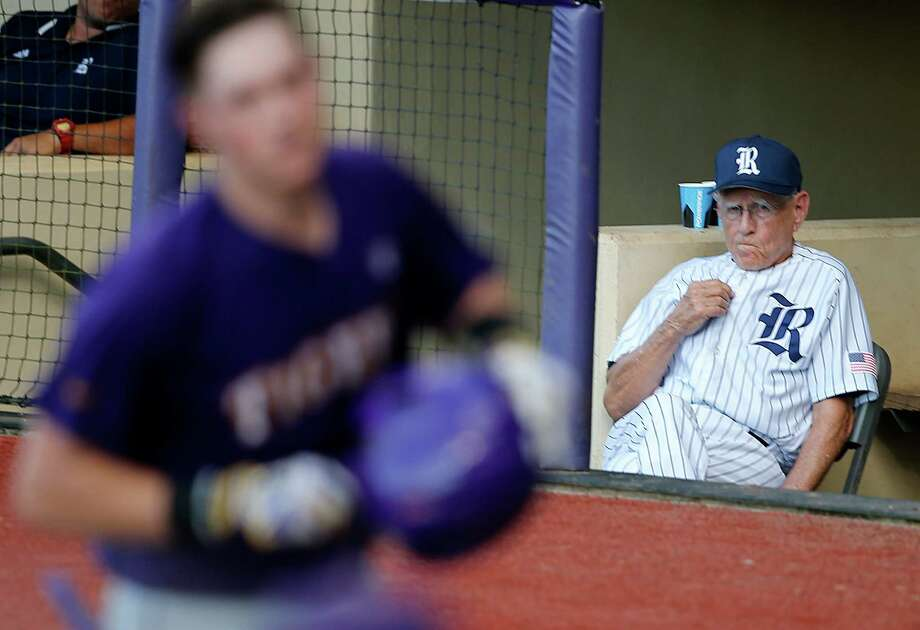 Rice head coach Wayne Graham watches from the dugout as LSU's Michael Papierski, foreground, crosses the plate on his solo homer in the eighth inning of an NCAA college baseball tournament regional game in Baton Rouge, La., Tuesday, June 7, 2016. LSU won 5-2 to advance to the Super Regionals. (AP Photo/Gerald Herbert) Photo: Gerald Herbert, Associated Press / Copyright 2016 The Associated Press. All rights reserved. This material may not be published, broadcast, rewritten or redistribu