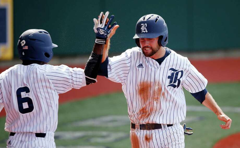 Rice's Grayson Lewis is greeted by Ryan Chandler (6) after scoring on an RBI double off the bat of Connor Teykl in the first inning against LSU in an NCAA college baseball regional tournament in Baton Rouge, La., Tuesday, June 7, 2016. (AP Photo/Gerald Herbert) Photo: Gerald Herbert, Associated Press / Copyright 2016 The Associated Press. All rights reserved. This material may not be published, broadcast, rewritten or redistribu