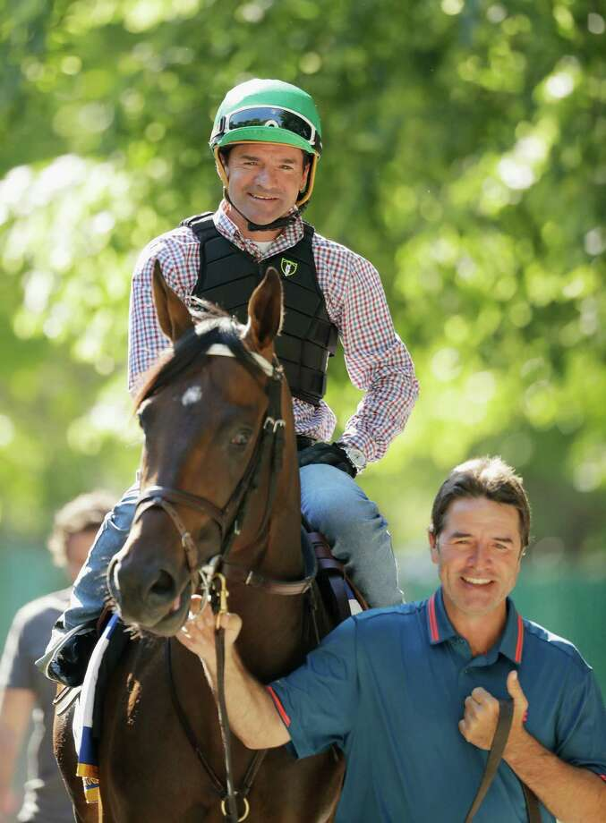 ELMONT, NY - JUNE 07:  Jockey Kent Desormeaux and trainer Keith Desormeaux take Exaggerator onto the track before a training session prior to the 148th running of the Belmont Stakes at Belmont Park on June 6, 2016 in Elmont, New York.  (Photo by Al Bello/Getty Images) ORG XMIT: 637228467 Photo: Al Bello / 2016 Getty Images