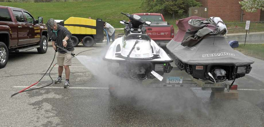 Dennis DiPinto, Director of Brookfield Parks and Recreation, uses a new decontamination unit the town has purchased during a training session last summer. Saturday, May 9, 2015, in Brookfield, Conn. Photo: H John Voorhees III / H John Voorhees III / The News-Times