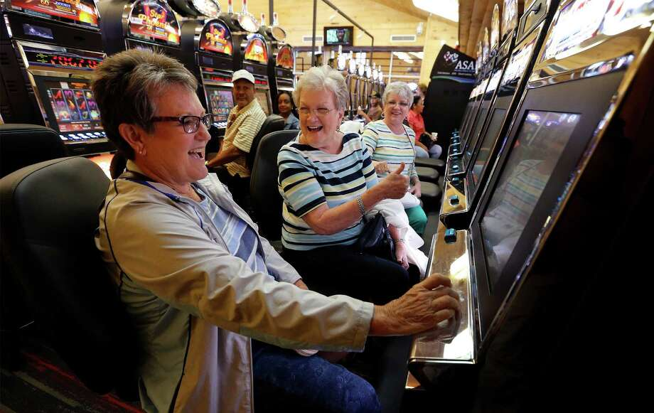 Trinity resident Shirley Sheffield, center, reacts as Patti Rau, left, wins on a gaming machine as their friend Jan Pistole watches on at Naskila Entertainment in Livingston on Tuesday. The Alabama-Coushatta tribe reopened its casino after a 14-year closure. Photo: Kin Man Hui, Staff / ©2016 San Antonio Express-News