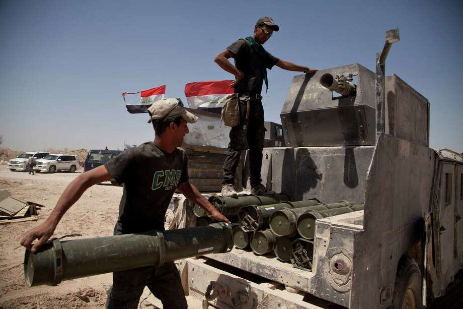 Iraqi counterterrorism forces load a Humvee with rockets to take to a front line position in their fight to oust Islamic State militants from Fallujah, Iraq, Tuesday, June 7, 2016. (AP Photo/Maya Alleruzzo) Photo: Maya Alleruzzo, STF / PA Wire