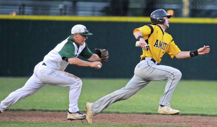 New Milford's Brendon Profita (15) runs down Amity's Patrick Winkel (30) for the out in the Connecticut high school Class LL boys baseball semifinal game between New Milford and Amity high schools. Tuesday night, June 7, 2016 at Muzzy Field, Bristol, Conn. Photo: H John Voorhees III / Hearst Connecticut Media / The News-Times