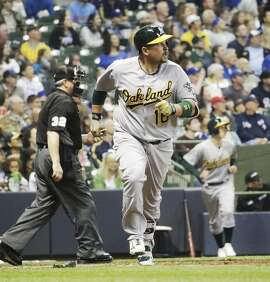 Oakland Athletics' Billy Butler hits a two-run home run during the seventh inning of a baseball game against the Milwaukee Brewers Tuesday, June 7, 2016, in Milwaukee. (AP Photo/Morry Gash)