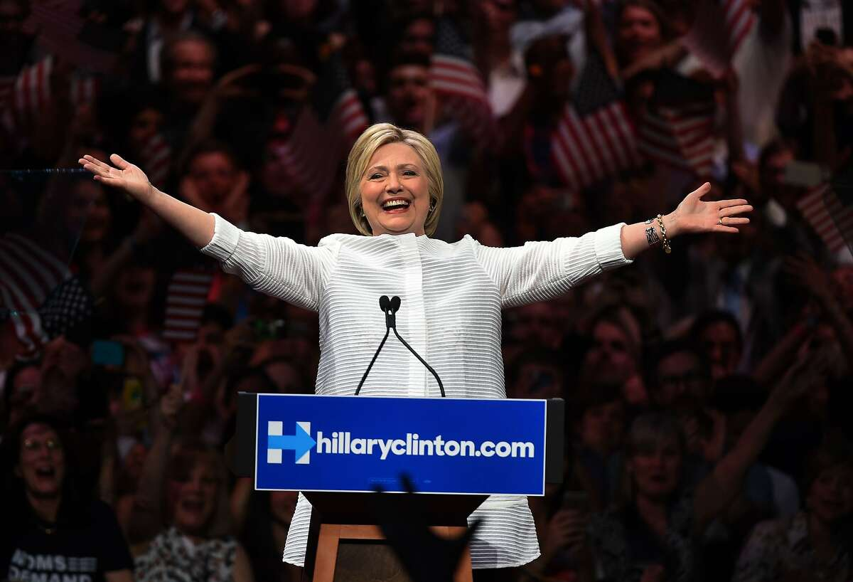 Democratic presidential candidate Hillary Clinton acknowledges cheers from the crowd during her primary night event at the Duggal Greenhouse, Brooklyn Navy Yard, June 7, 2016 in New York.