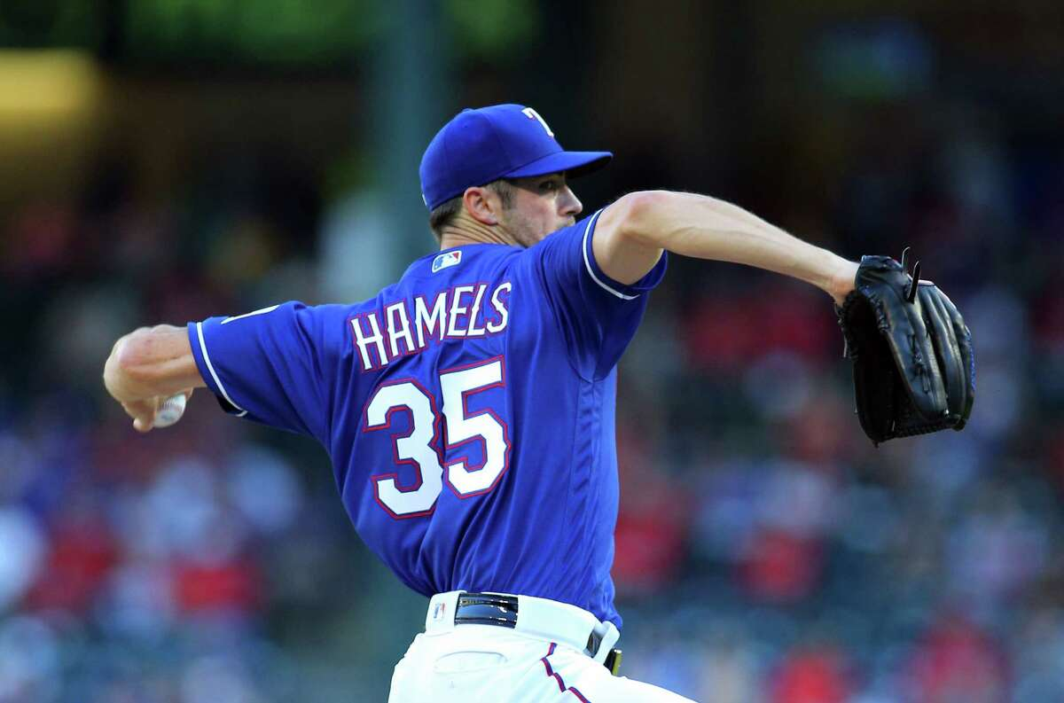 ARLINGTON, TX - JUNE 07: Cole Hamels #35 of the Texas Rangers pitches in the first inning against the Houston Astros at Globe Life Park in Arlington on June 7, 2016 in Arlington, Texas.