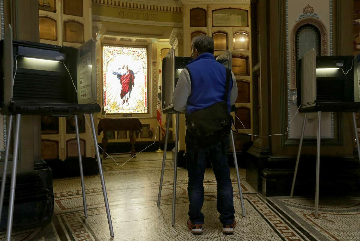Jeff Young votes at the Neptune Society Columbarium, one of the last remaining cemeteries in San Francisco, Tuesday, June 7, 2016. Voter turnout is expected to be higher then normal in the nation's most populous state for Tuesday's presidential primary.