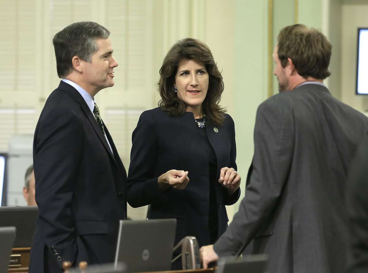 FILE - In this Sept. 8, 2015 file photo, Republican Assembly members David Hadley, of Manhattan Beach, left, Catharine Baker, of Dublin, and James Gallagher, of Nicolaus, huddle during the Assembly session, in Sacramento, Calif. Democrats are spending and campaigning heavily to try to bolster their majorities in both houses of the California Legislature. Edging out Republicans ahead of November 2016 is key to their strategy as voters narrow the field on Tuesday, June 7, 2016. (AP Photo/Rich Pedroncelli, File)