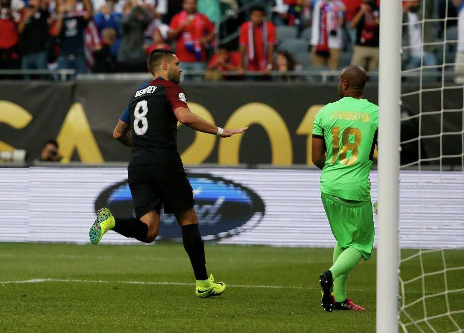 United States' Clint Dempsey (8) celebrates after kicking a goal against Costa Rica's Patrick Pemberton (18) during a Copa America Centenario group A soccer match at Soldier Field in Chicago, Tuesday, June 7, 2016. (AP Photo/Charles Rex Arbogast) ORG XMIT: CXB110 Photo: Charles Rex Arbogast / Copyright 2016 The Associated Press. All rights reserved. This m