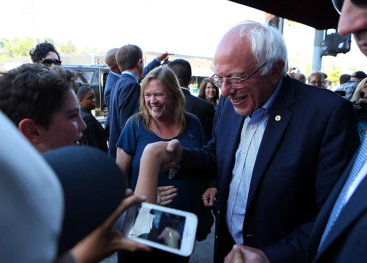 Sen. Bernie Sanders shakes hands with a teenager while campaigning in the Silverlake Neighborhood of Los Angeles, on the day of the California primary, June 7, 2016. The Associated Press said on Monday that Hillary Clinton had garnered enough support to be declared the Democrats?' presumptive presidential nominee. (Jim Wilson/The New York Times)