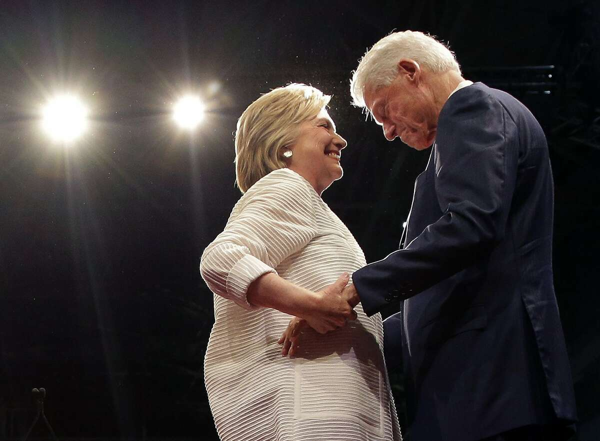 Democratic presidential candidate Hillary Clinton, second from right, greets her husband, former president Bill Clinton during a presidential primary election night rally, Tuesday, June 7, 2016, in New York.