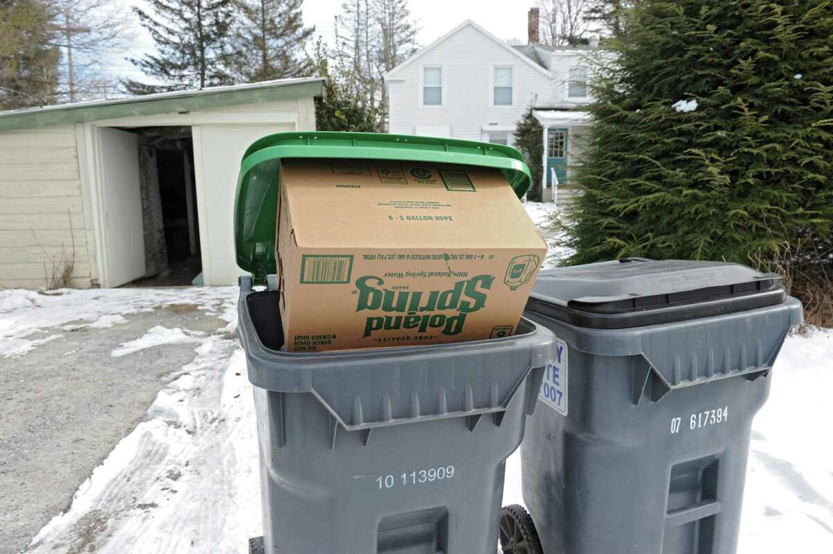 An empty case of Polar spring water is seen in a recycling receptacle in front of a house on Friday, Feb. 12, 2016 in Hoosick Falls, N.Y. (Lori Van Buren / Times Union)