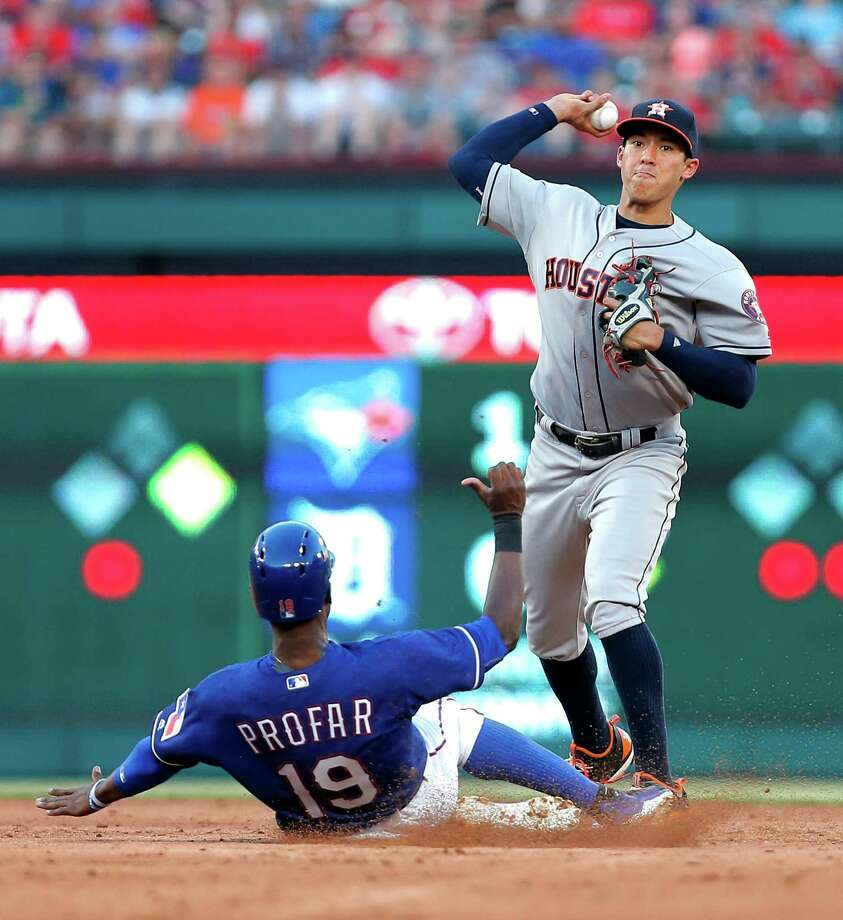 Houston Astros shortstop Carlos Correa (1) throws to first to turn a double play after forcing out Texas Rangers' Jurickson Profar (19) during the third inning of a baseball game Tuesday, June 7, 2016, in Arlington, Texas. (AP Photo/Brandon Wade) Photo: Brandon Wade, FRE / FR168019 AP