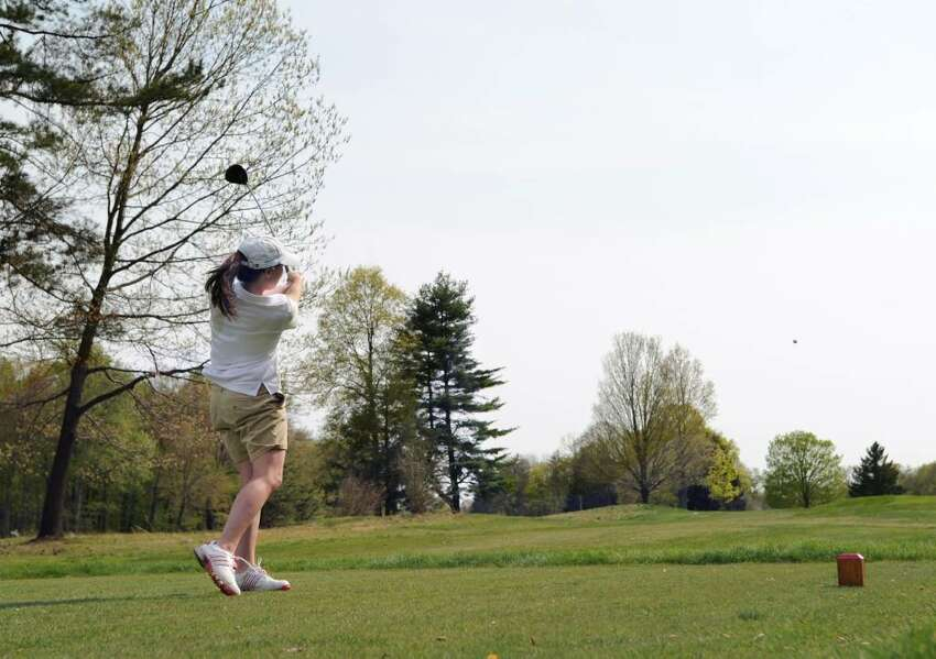 Lili Rosenkranz of Greenwich Academy watches her ball disappear into the distance as she hits off the 2nd tee during match play against The Hotchkiss School and The Taft School at Round Hill Club, Greenwich, Wednesday, April 21, 2010.
