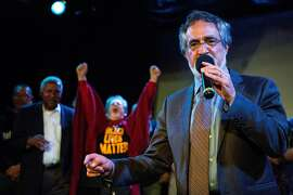 Aaron Peskin gives a speech as Hene Kelly cheers in agreement at  the Jane Kim election night party at Oasis in San Francisco, Calif. on Tuesday, June 7, 2016.