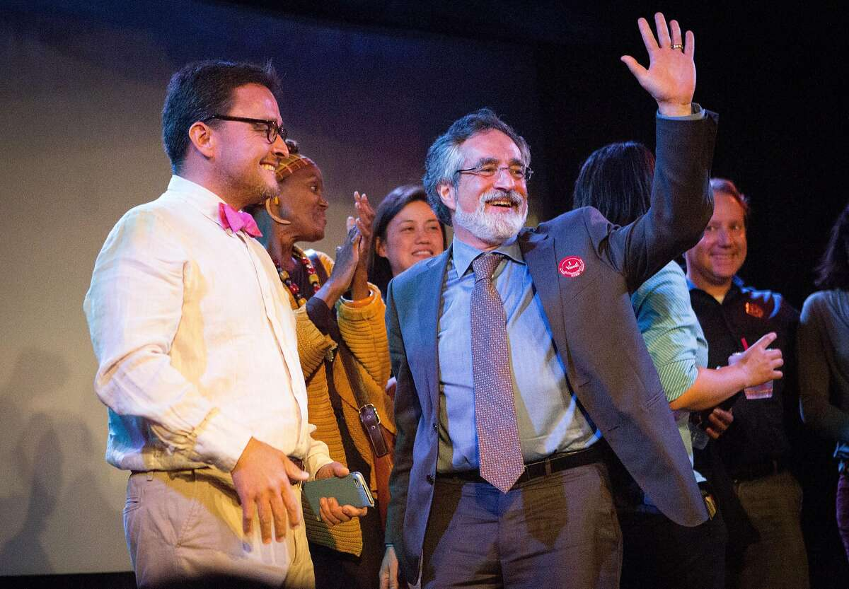 David Campos and Aaron Peskin cheer on the local elected officials he's affiliated with at the Jane Kim election night party at Oasis in San Francisco, Calif. on Tuesday, June 7, 2016.