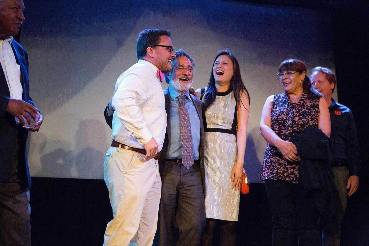 David Campos, Aaron Peskin, and Cindy Wu cheer on the local elected officials he's affiliated with at the Jane Kim election night party at Oasis in San Francisco, Calif. on Tuesday, June 7, 2016.
