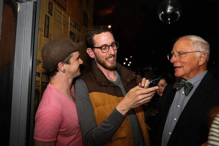 Supervisor Scott Wiener (center), who is running for State Senate looked at his phone with friends Brian Wyatt (left) and John Newmeyer (right) during Wiener's election party, at Blackbird, in San Francisco, California, on Tuesday, June 7, 2016.