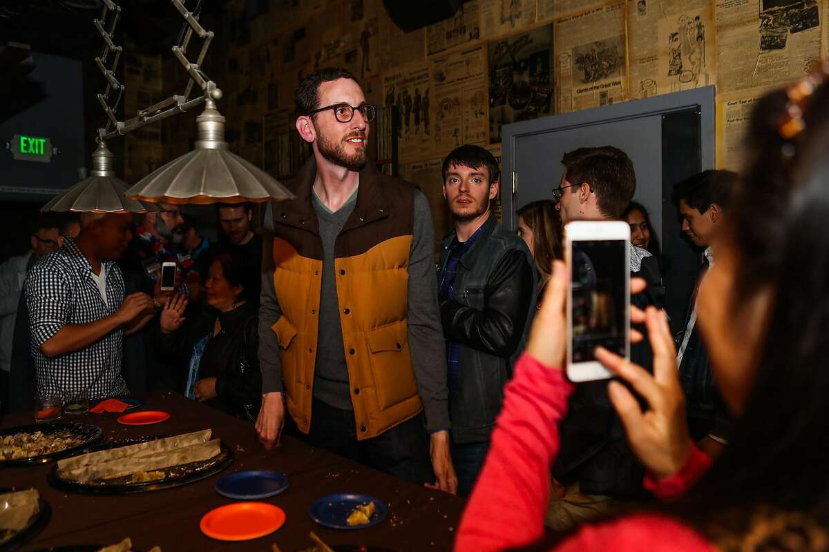 A woman photographs Supervisor Scott Wiener (left), who is running for State Senate during his election party, at Blackbird, in San Francisco, California, on Tuesday, June 7, 2016.