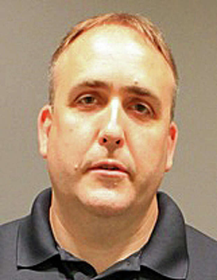 "Gregg Gustafson, 46, of Bridgeport, was charged with tampering with a witness, criminal attempt at bribery of a witness and tampering with or fabricating evidence, according to Stratford police. The former math teacher at Stratford High School is accused of ""inappropriate actions"" involving several students prior to his resignation from the faculty, according to Stratford police. Photo: Stratford Police Department Photo"