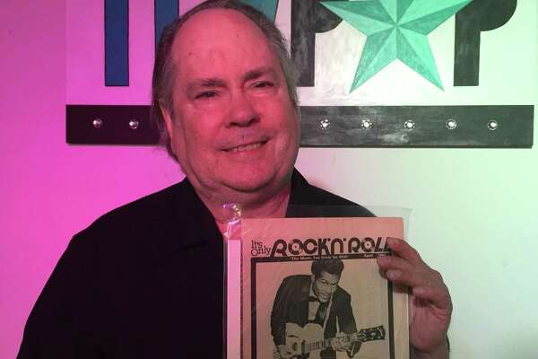 Music journalist Ron Young holds a copy of It's Only Rock 'N' Roll, an alternative newspaper he published in San Antonio from 1978 to 1982.