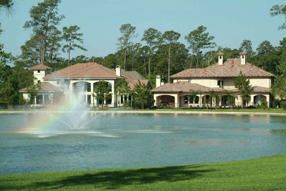 These Fall Creek homes are overlooking a water feature. Most homes are priced above $190,000. Photo: Courtesy