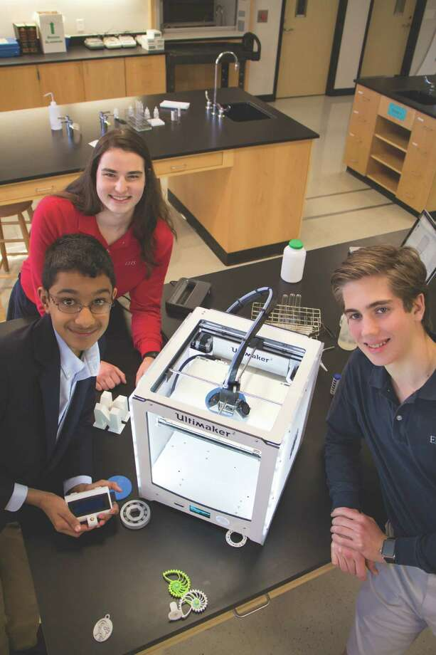 Episcopal High School students Rohan Asthana, Brooke Doyle and Austin McGinnis work with the school's 3D printer. Photo: Ashleigh Teel