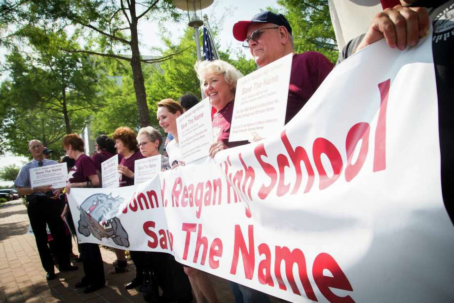John H. Reagan High School alumni Robert Heath, right, and Kay Potter Cella, center, protest Houston school district's plan to rename several schools, Thursday, May 12, 2016, in Houston. ( Marie D. De Jesus / Houston Chronicle ) Photo: Marie D. De Jesus, Staff / © 2016 Houston Chronicle
