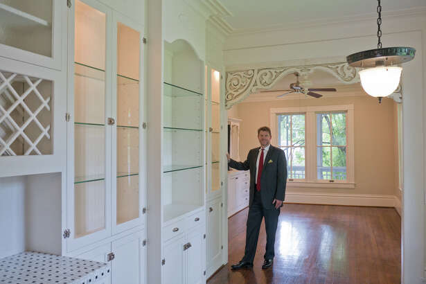 Bill Baldwin of Boulevard Realty shows the interior of a kitchen in a home at 205 E. Fifth St. in the Heights  The 2 1/2-story house has a number of interesting architectural features.