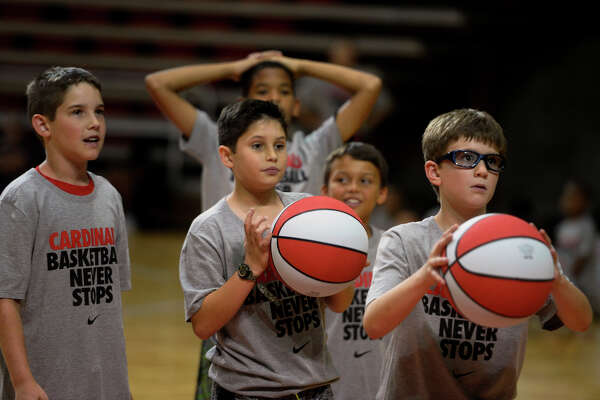 Children line up to play a game of knock out during Lamar University's basketball camp in the Montagne Center on Tuesday afternoon.  Photo taken Tuesday 6/7/16 Ryan Pelham/The Enterprise