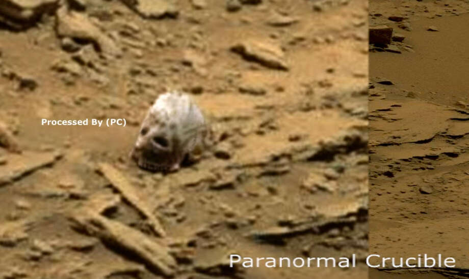 An object that appears to be a skull was captured by a NASA rover. Photo via Paranormal Crucible. Here is the link to the raw image on NASA's website.The object appears in the upper left of the raw image.