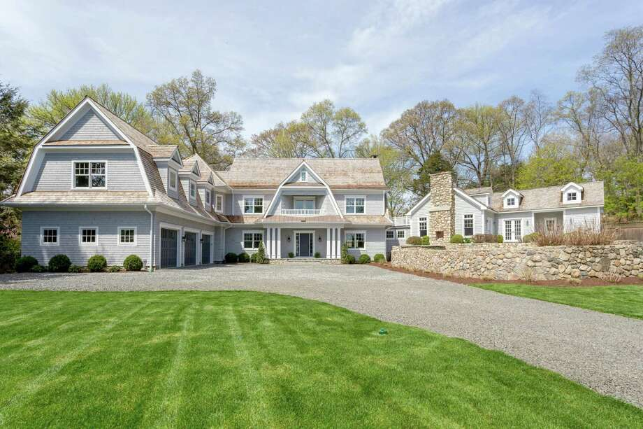 Set back from the road on Five Mile River, this private, transitional-style Colonial offers a new construction home with a direct waterfront parcel across the road with a one-year water slip on Five Mile River. Photo: Contributed Photos