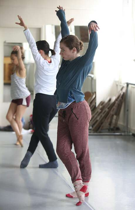 San Francisco Ballet principal James Sofranko (left) works with SF Danceworks dancers Anne Zivolich-Adams (back), Dana Genshaft and Amber Neumann (middle) during the second day of rehearsalson June 6 in San Francisco. Photo: Liz Hafalia, The Chronicle