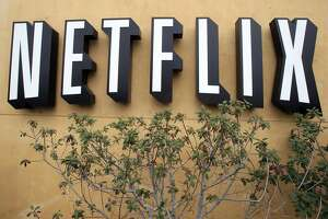 FILE - In this April 22, 2011 photo, the logo of Netflix is displayed at the headquarters in Los Gatos, Calif. Netflix has enjoyed top billing before: it was the biggest gainer in the S&P 500 in 2010 and 2013, and more than tripled in value both years. But another big year in 2015 pushed the company�s value past established media rivals like CBS and made it about the same size as Time Warner. (AP Photo/Paul Sakuma, File)
