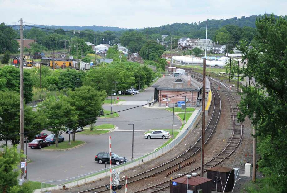 A view of the Danbury Metro-North train station from the Patriot Garage in Danbury, Conn. on Friday, July 12, 2013.  Regional Plan Association released a study showing only half the towns with Metro-North stations have development regulations deemed conducive to transit-oriented development. Photo: Tyler Sizemore / Tyler Sizemore / The News-Times