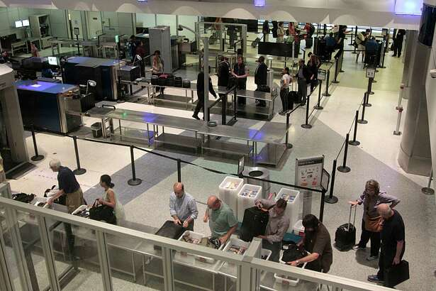 Passenger wait in a Transportation Security Administration (TSA) screening line at George Bush Intercontinental Airport Wednesday, June 1, 2016, in Houston.  ( James Nielsen / Houston Chronicle )
