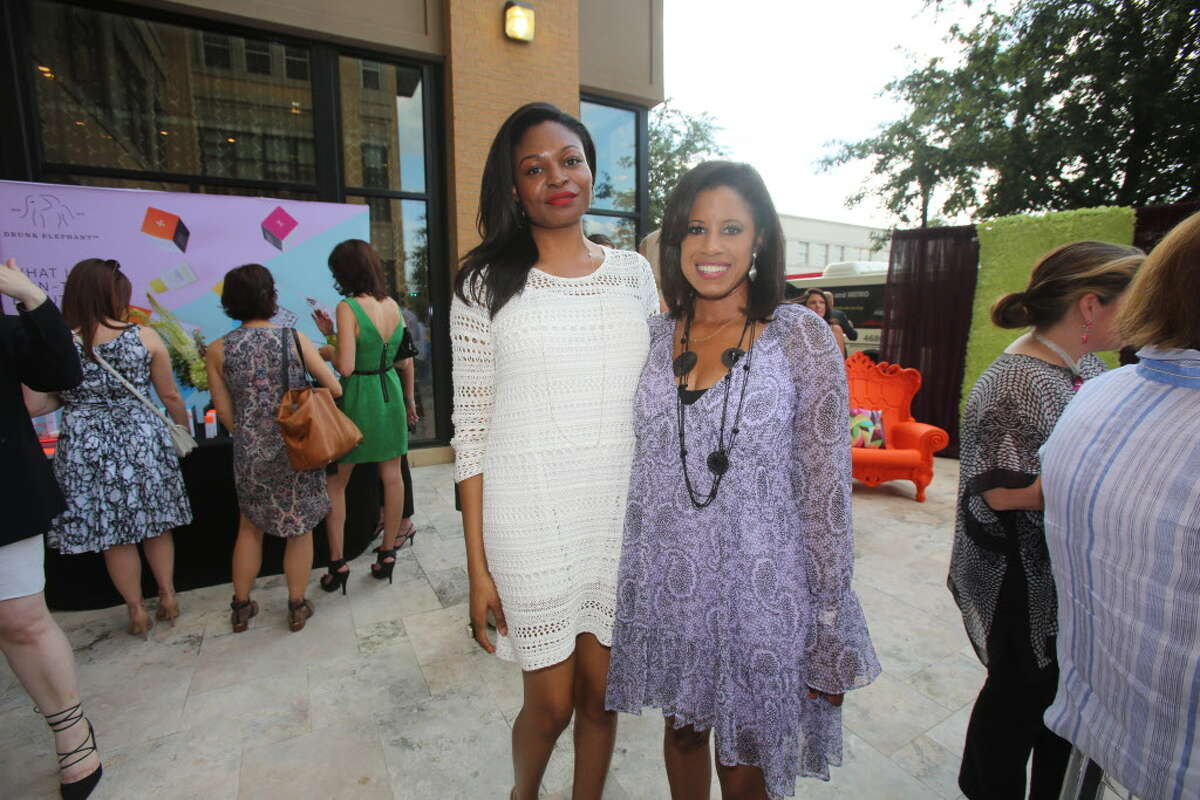 Ronke A. and Adrian Kreps at TOOTSIES' patio party benefiting the Texas Lyme Disease Association.
