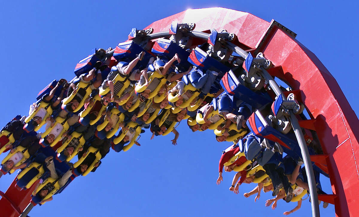 Thrill seekers spin up side down on the new Superman Krypton Coaster at Fiesta Texas as the park opens for the season Saturday, March 11, 2000. Fiesta Texas and Sea World opened for spring break on the weekends till Memorial Day when they open daily for the summer. AP Photo/Express-News,Tom Reel