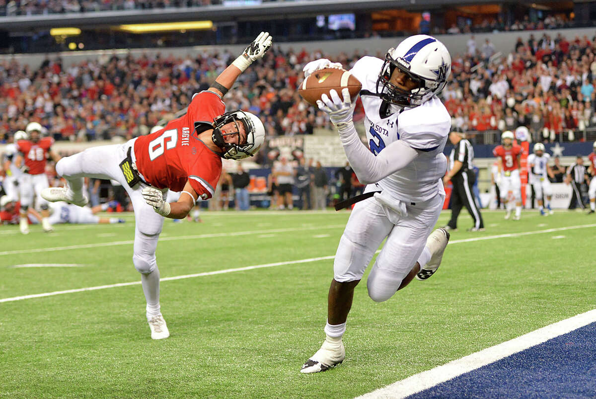 Navasota wide receiver Tren'Davian Dickson (2) catches a pass as he crosses the goal line in double over time as Argyle defensive back Zach Zembraski (6) defends during the Texas UIL 4A Division I State Championship football game, Friday, Dec. 19, 2014 in Arlington, Texas. (AP Photo/The Bryan-College Station Eagle, Sam Craft) MANDATORY CREDIT