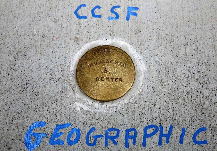 X — actually, it's a piece of brass — marks the spot surveyors have determined is the center of San Francisco. Photo: Connor Radnovich, The Chronicle