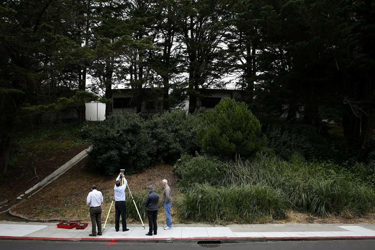 Michael McGee (left), Bruce Storrs, Rachel Gordon and Neil King of San Francisco Public Works hang around the geographic center of San Francisco, California, on Wednesday, June 8, 2016.