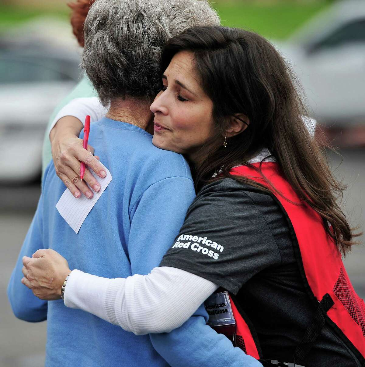 American Red Cross volunteer Adriana Casso hugs a resident of Wedgwood Nursing Home after a fire at the home near Blanco rd and 410 forced the evacuation of residents early Sunday, December 28, 2014 in San Antonio, Texas. Evacuees were taken to nearby Winston Churchill High School were they met with family members and waited for buses which took them to nearby hotels.