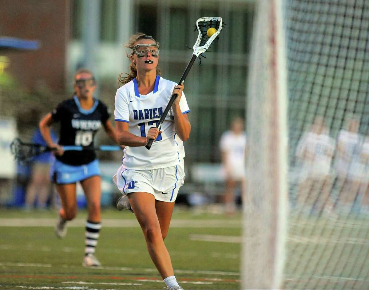 Darien's Susannah Ropp drives to the net for a score during Tuesday's win over Wilton in the CIAC Class L girls lacrosse semifinal game at Taft Field in Fairfield.