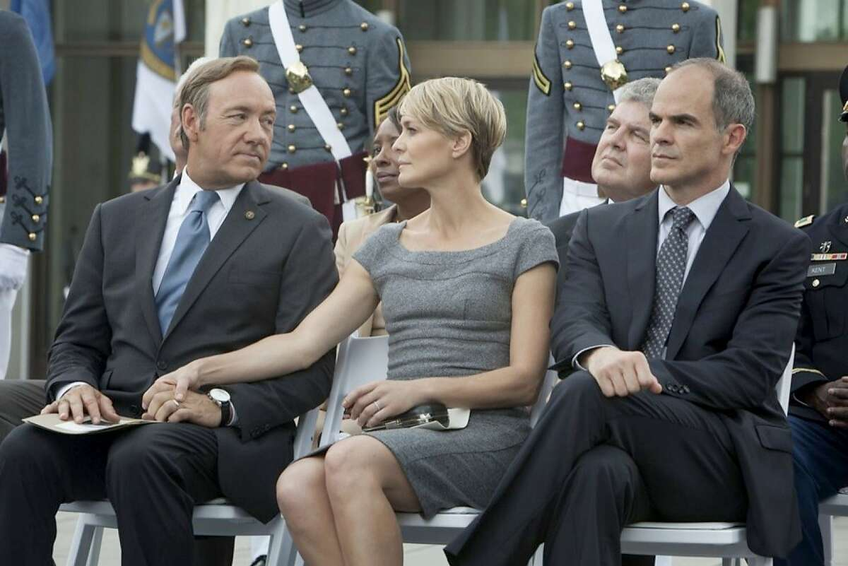 Kevin Spacey, Robin Wright and Michael Kelly in a scene from Netflix's House of Cards.