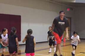 Boban Marjanovic played basketball with young athletes at the Spurs' All-Girls Summer Camp on June 7, 2016.